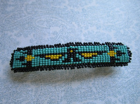 hand beaded barrette I made by hand, no loom, and sewed to a piece of doe skin and onto a metal barrette